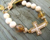 CREAM and RHINESTONE CROSS Bracelet  Cream Enamel and Gold Cross  White Howlite Beads  Brass and Leather Button Clasp