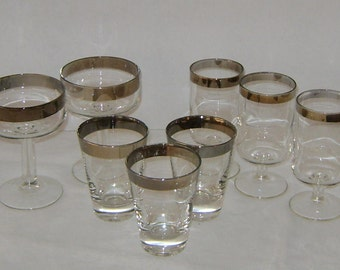 Assortment of Mid Century Silver Banned Glassware