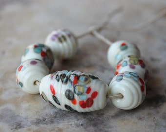 ribbed glass bead lampwork set off white and multicolor specks