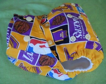 Choose your custom Basketball team. SassyCloth one size pocket diaper with basketball cotton print. Made to order.