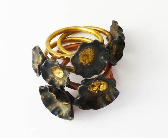 Tiny black poppy stacking ring