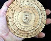 Word Wheel Puzzle - configure the wheels such that you have at least two 4-letter words showing at the same time.