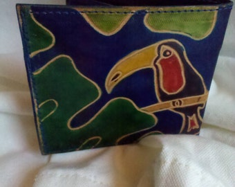 Vintage Leather Wallet with Colorful Cockatoo, Royal Blue Background, and Green Foliage
