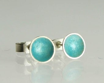 Tiny sterling silver stud earrings with turquoise blue enamel