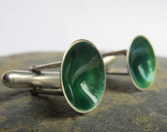 Sterling silver cuff links with emerald green enamel