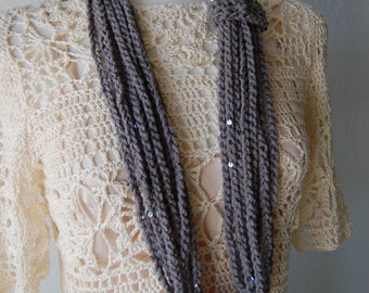 Crochet scarf of chains in graphite grey with  sequins