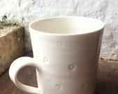 White spotty porcelain mug