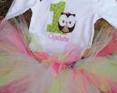 1st birthday owl bodysuit with name, colorful tutu, and matching hair bow
