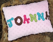 Personalized pillow for baby girl with name appliqué and minky material