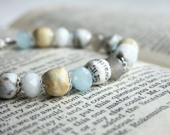 Pale blue and yellow beaded bracelet, fabric and book page beads in pastel blue and yellow