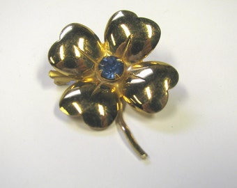 Vintage Dog Wood Flower Gold tone Brooch With Blue Rhinestone, signed Coro