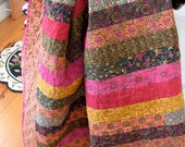 Throw-sized Quilt in colorful shades of pink