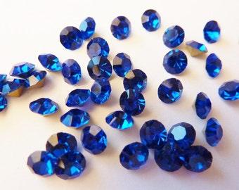 24 rhinestones SS23, Ø5mm, dark sapphire