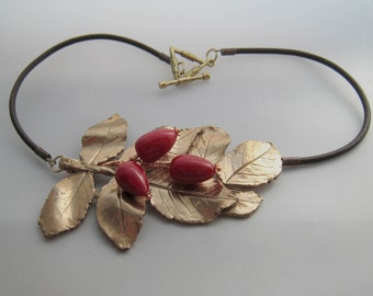 Rosehip handmade metal clay and lampworked glass necklace OOAK
