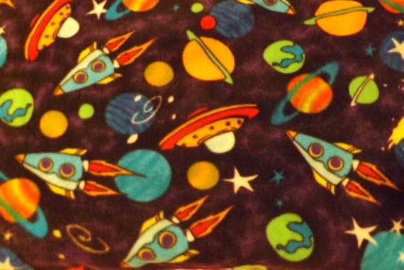 fleece fabric bty multi colored space ships and by