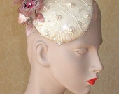 Ivory silk beaded cocktail hat.