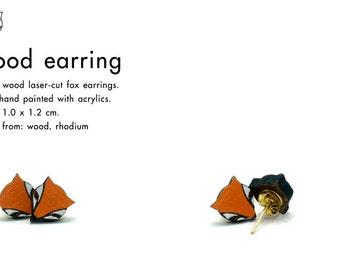 Wood laser-cut fox earrings.