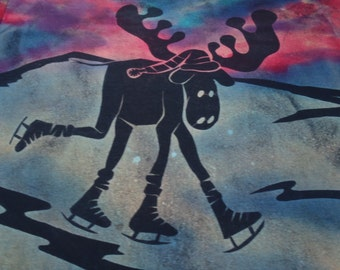 My favorite moose ice skating across the frozen pond, XL man's discharge t-shirt, and then dyed with procion dyes, blues, pinks, and purlpes