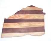 Georgia  cutting board is made from oak and walnut