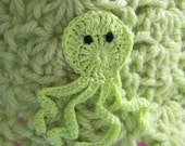 Octopus crochet baby beanie with earflaps for 6 to 9 mos.