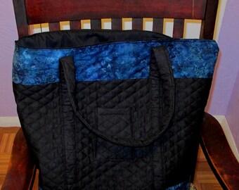 Black quilted tote, purse, handbag, book bag.