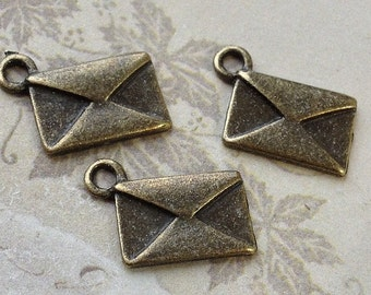 13 mm x 9 mm Antiqued Bronze Love Letter Charms (.tgs)