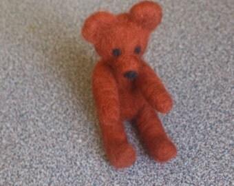 Miniature teddy bear needle felted in maroon merino wool