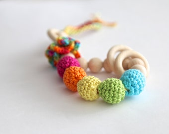 Teething toy rattle with crochet wooden beads and 3 wooden rings. Yellow, orange, blue, green, pink.