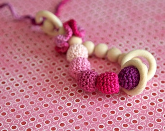 Teething toy rattle with crochet wooden beads and 3 wooden rings. Pink, lilac, purple