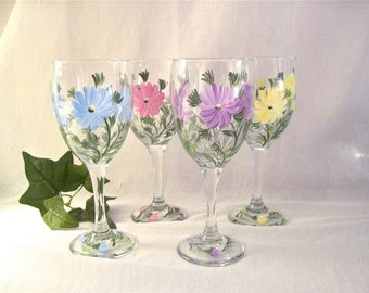 Wildflowers hand painted on a pretty set of four wine glasses