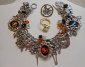 Coupon code for 20% off The Hunger Games Charm Bracelet With Mockingjay Pin, Arrow Ring, Necklace And Magnets