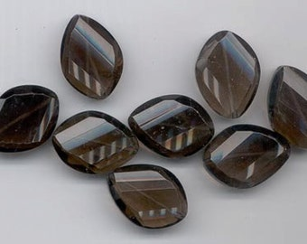 Eight lovely smoky quartz beads - helical faceting - 25 x 18 mm