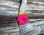 adorable shabby chic gray and white polka dot headband with hot pink flower and green leaves