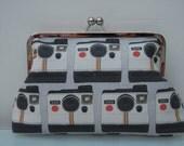 Polaroid clutch handbag