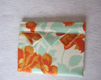 Lined and padded spring-shut makeup case in designer fabric RTS
