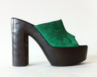 Vintage wooden platform heels in emerald green suede leather