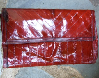 Sleek Genuine EEL Skin Ruby Clutch Bag c 1980