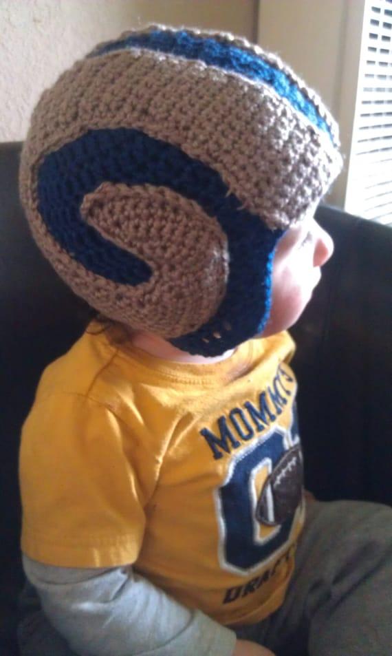 69164c03ea0 Rams inspired crochet hat with horns applique jpg 570x953 Rams hat with  horns