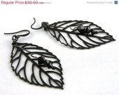 20 % VACATION SALE Black leaf and ruby Swarovski crystal earrings
