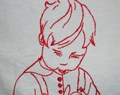 Vintage red work embroidery Little Boy Peeling Apples on a white muslin with a red and white lace trim all  by hand