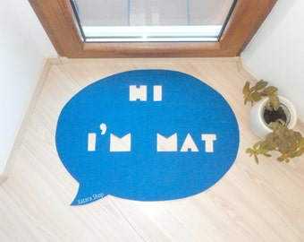 "Home decor floor mat. Speech bubble shape ""Hi, I'm Mat"""