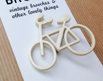 Vintage bicycle brooch white