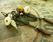 Algedonic.  Oxidized metals, shell, vintage glass, and bone rustic dangle earrings
