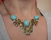 Gold statement necklace with crystals and turquoise stones