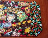 Set of 4 Reversible Quilted Placemats - Mary Engelbreit Mary's Mottos on Black with Classic Floral -