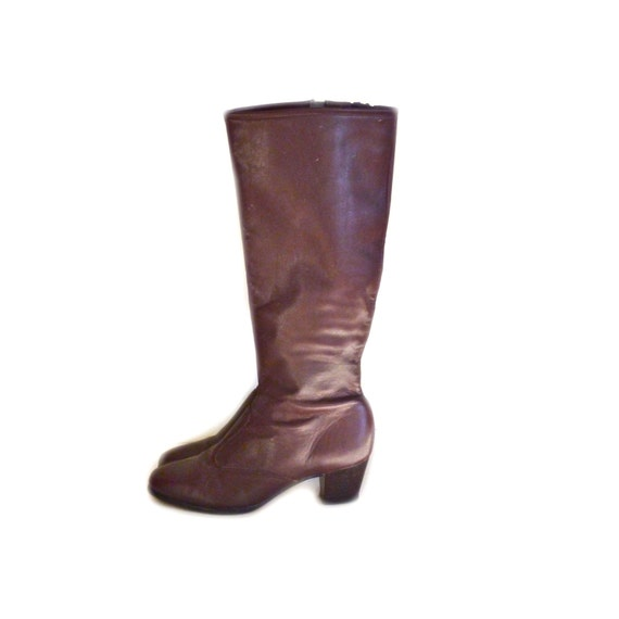 leather boots knee high burgundy stacked by