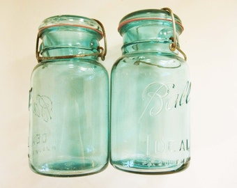 Two Very Old Ball Jars With Wire Bales and Matching Ridged Tops - Blue Green Glass - Primitive - Stash and Store