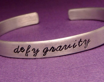 Wicked Inspired - Defy Gravity - A Hand Stamped Bracelet in Aluminum or Sterling Silver