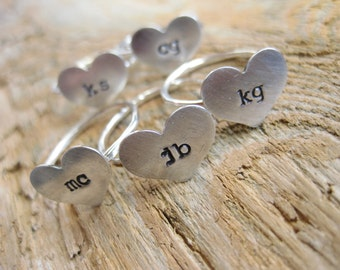 Bridesmaid's hand stamped heart rings