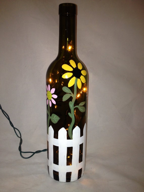 Hand painted recycled wine bottle with flowers and a picket for Painting flowers on wine bottles